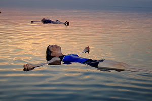 people floating in dead sea